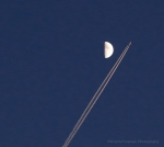 A plane going over the moon